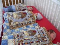sleeping-trio-in-crib.jpg